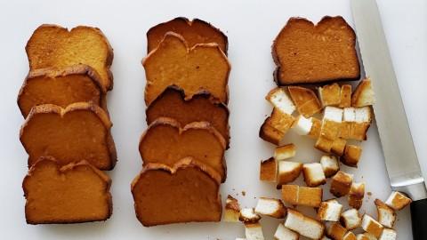 Cutting toasted angel food cake on ShockinglyDelicious.com
