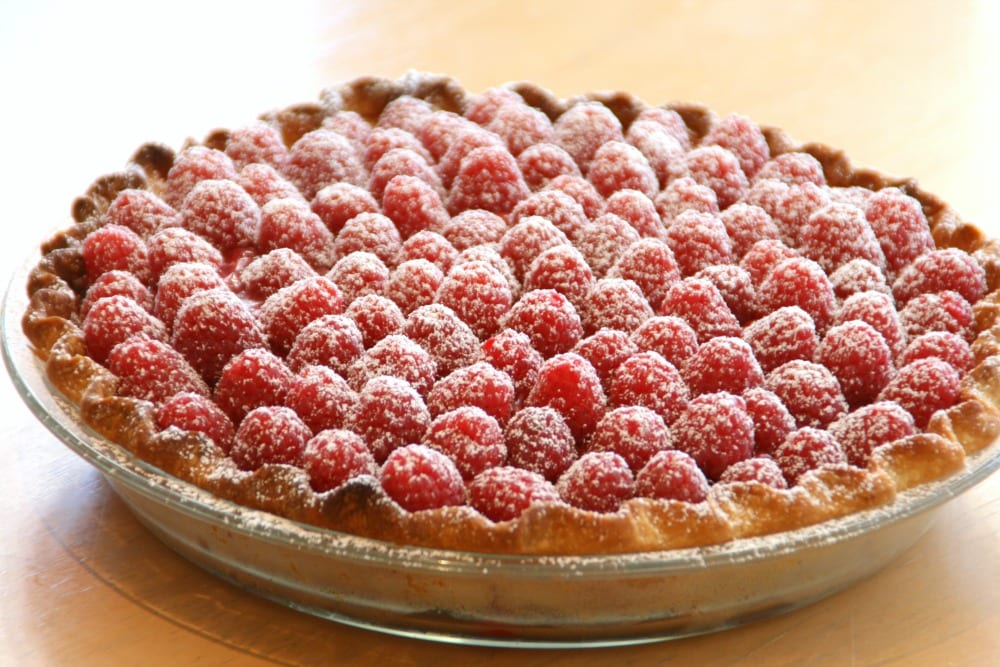 Fresh Raspberry Pie on a wooden tabletop