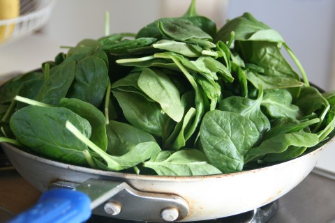 Wilting spinach in a skillet on Shockinglydelicious.com