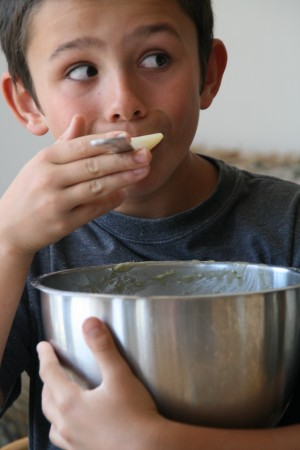 Boy eating more batter