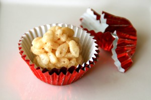 Truffled Rice Krispies Treats in red foil cup on Shockingly Delicious