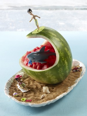Surfer on wave carved watermelon