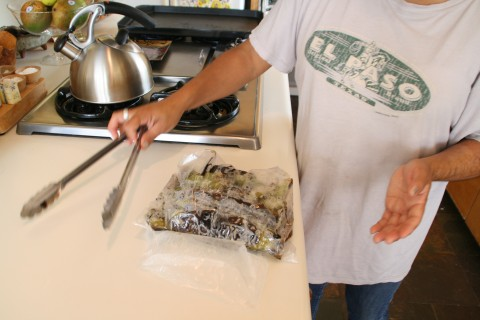 Hatch chiles steam on the counter in a bag