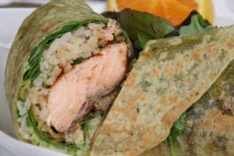 Salmon Wrap Sandwich from The Godmother Cafe of Malibu. Zippy, lemony wasabi mayonnaise on a spinach tortilla stuffed with marinated, grilled salmon, fresh spinach and healthy brown rice makes an unforgettable and gorgeous wrap for lunch or dinner!