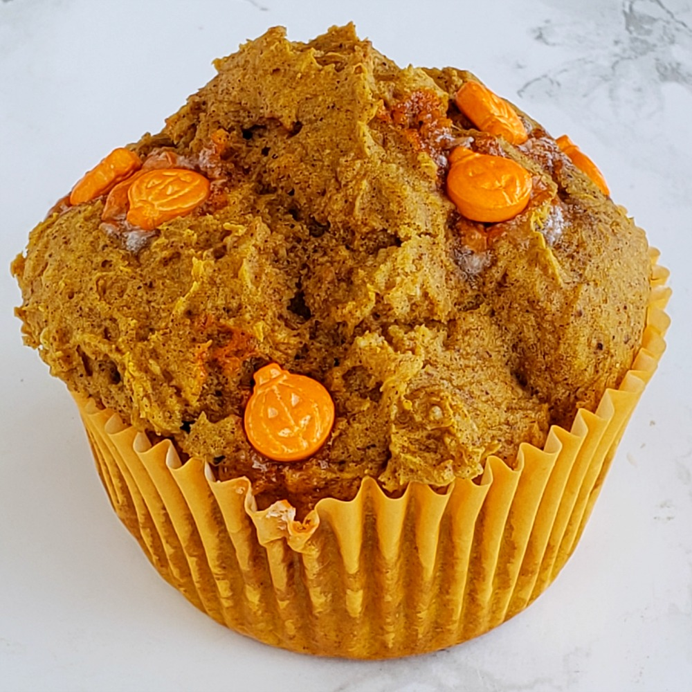 Easy Cheater Pumpkin Muffins have candy pumpkins on top