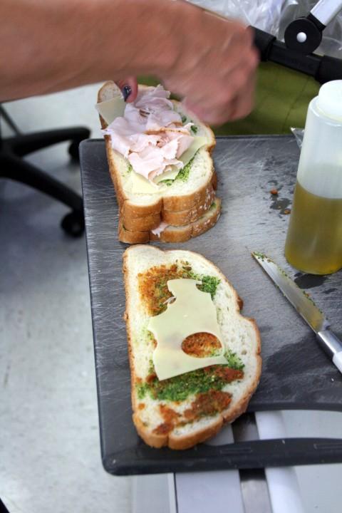 Turkey Pesto Panini making sandwiches