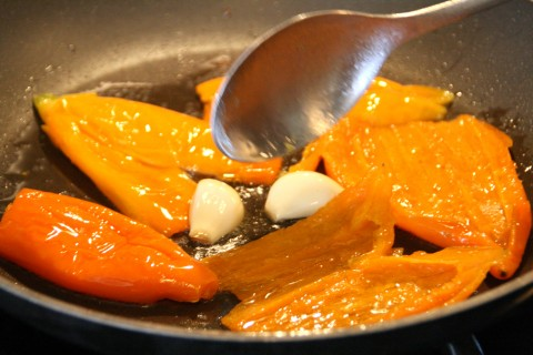 Saute peppers and garlic in a skillet