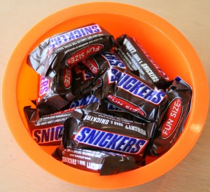 Snickers Bars in an orange bowl