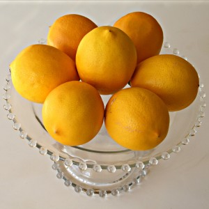 Meyer lemons on a cakestand