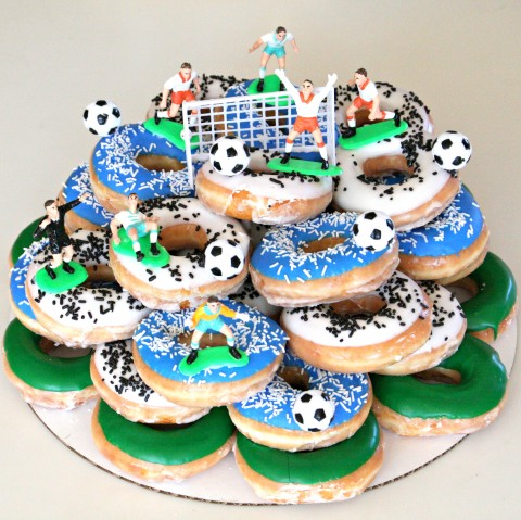 You'll have a HUGE WIN with a Donut Cake, which is simply decorated donuts arranged in stacked tiers. My son considers this Donut Soccer Cake the best cake of all time.