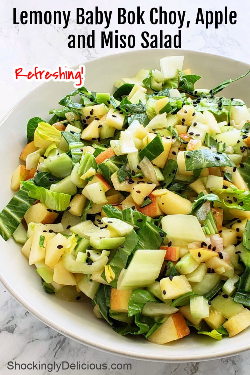 Lemony Baby Bok Choy, Apple and Miso Salad with recipe title superimposed on top of the photocom
