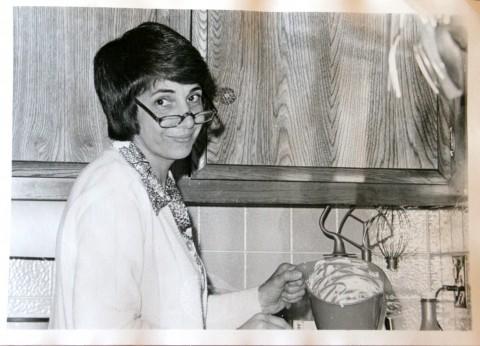 Helen Reinhold cooking, circa 1970s