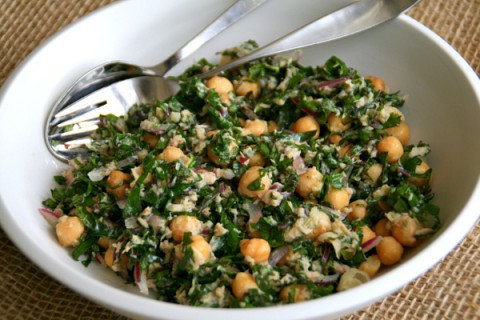 Kale Salad in a white bowl on burlap