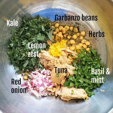 Ingredients in bowl for Lemony Garbanzo Kale Salad with Tuna on ShockinglyDelicious.com
