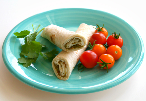 Poor Man's Burrito or Hatch Chile Roll-Up on a turquoise plate
