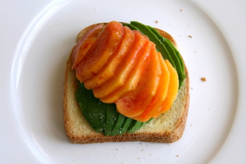 Peach and avocado slices on toast