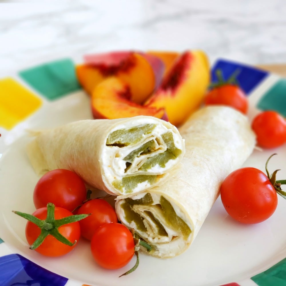 POOR MAN'S BURRITO: A Hatch chile wrapped up with garlicky cream cheese in a flour tortilla becomes a Poor Man's Burrito, perfect for tailgating, any party, lunch or a snack!