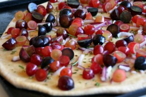 Flatbread with Grapes, Gruyere, Rosemary and Red Onions on Shockingly Delicious.