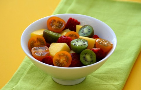 Fruit Salad with Tomatoes and green napkin on ShockinglyDelicious