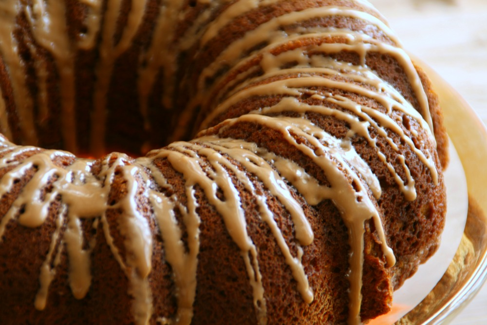 Spiced Pumpkin-Pecan Bundt Cake with Maple Glaze showing the top of the cake