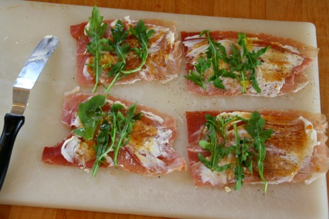 Assembling the Prosciutto Goat Cheese Rolls with Fig Preserves and Arugula on Shockingly Delicious. Recipe here: http://www.shockinglydelicious.com/?p=10622