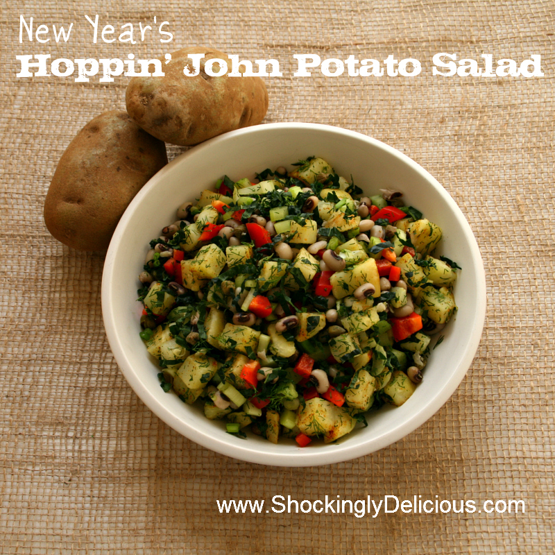 New Year's Hoppin' John Potato Salad in a white bowl against a burlap background