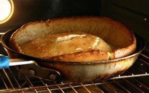 Dutch Baby Oven Pancake puffing up high in the oven