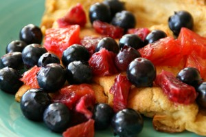 Dutch Baby Oven Pancake with blueberries and blood oranges