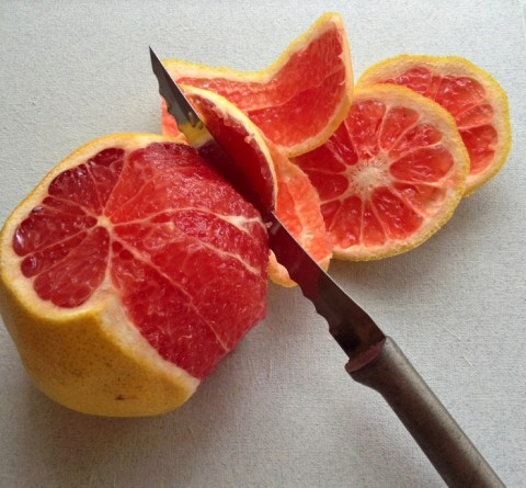 Grapefruit cutting into supremes on Shockingly Delicious