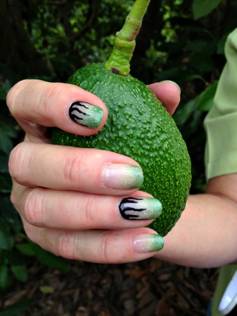 Jan DeLyser holds a Haas avocado on Shockingly Delicious