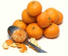 Kishu mandarins compared to a spoon