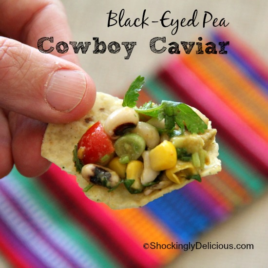 Black-Eyed Pea Cowboy Caviar on a corn chip against a Mexican fabric background