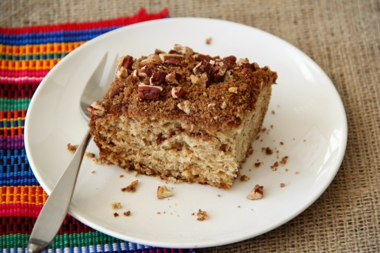 Banana Breakfast Cake with Pecan Streusel Topping on a white plate