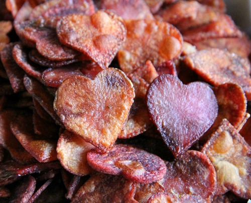 Potato slices cut into heart shaped, dyed with beet juice and baked for Heart-Shaped Potato Chips | www.ShockinglyDelicious.com