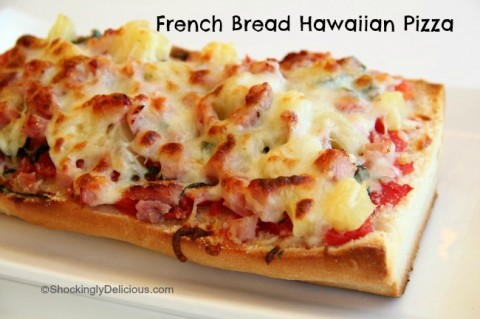 Baked piece of French Bread Hawaiian Pizza out of the oven