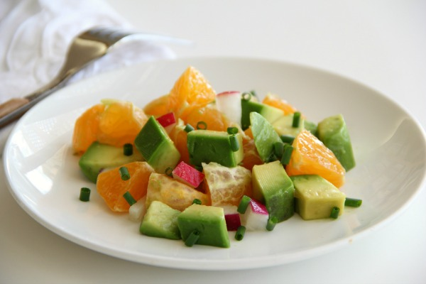 Super simple Pixie Dust Salad with Avocados, Pixie Tangerines and Radishes, lightly dressed in lemon-cumin | www.ShockinglyDelicious.com