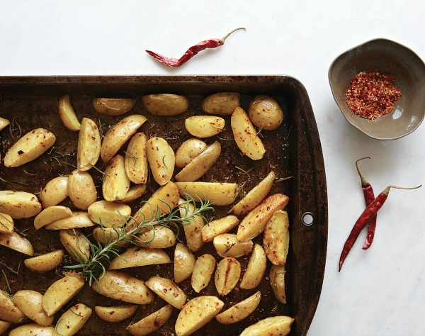 Chile Roasted Potatoes on a dark baking sheet