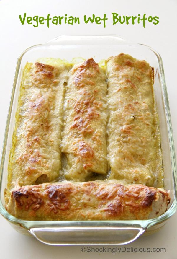 4 Vegetarian Wet Burritos in a glass baking dish on ShockinglyDelicious.com