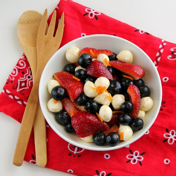 Red, White and Blue Fruit and Cheese Salad with wooden spoon and fork beside it | ShockinglyDelicious.com