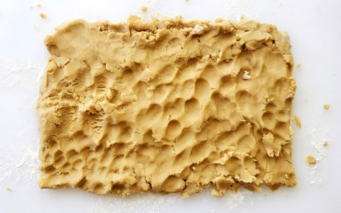 Brown Sugar Shortbread being patted on the board on ShockinglyDelicious.com
