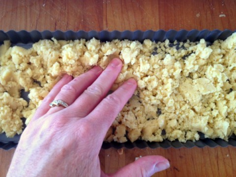 Pressing in crust for Persimmon Tart on ShockinglyDelicious.com