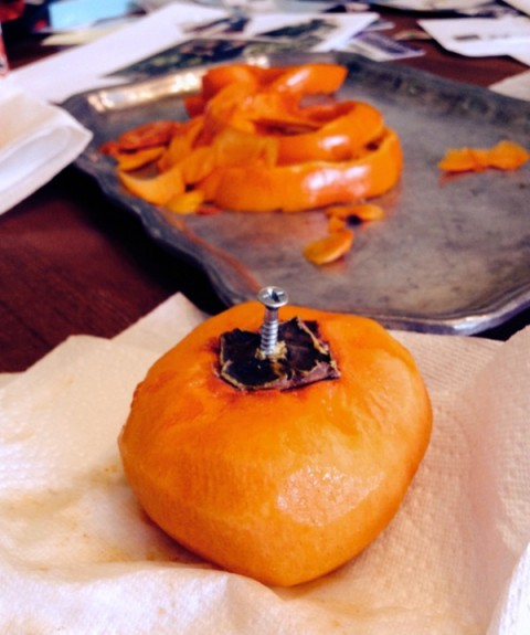 Put a screw in the persimmon to hang it on Shockingly Delicious