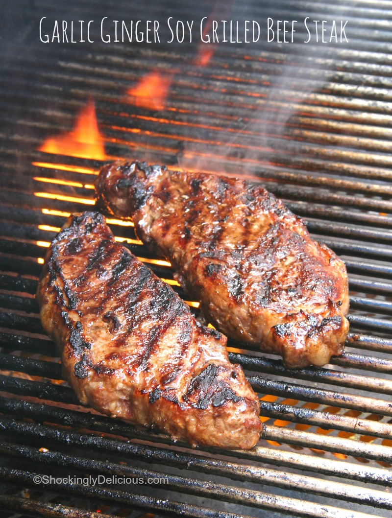 Garlic Ginger Soy Grilled Beef Steak on the flaming grill on ShockinglyDelicious.com