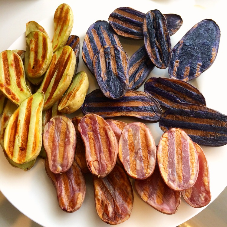 Grilled Tricolored Idaho Potato Fingerlings on a white plate