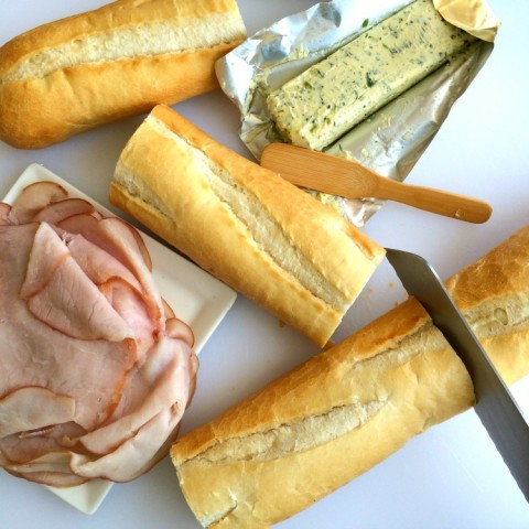 Cutting bread for French Ham and Butter Sandwich on ShockinglyDelicious.com