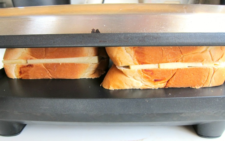 2 sandwiches in the panini maker on ShockinglyDelicious.com