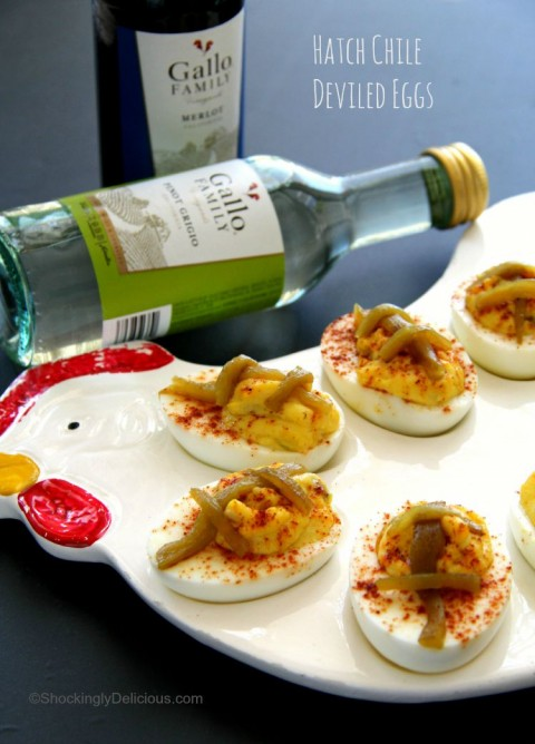 Little football-shaped Hatch Chile Deviled Eggs make great tailgating food. Easy recipe on ShockinglyDelicious.com