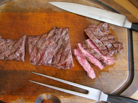 Flap Steak is sliced against the grain after grilling on ShockinglyDelicious.com