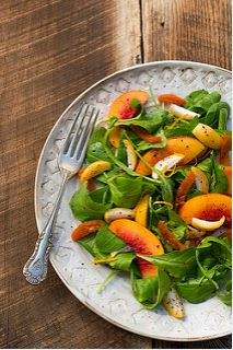 Arugula with Fresh Golden Dates, Dried Apricots, Nectarines and Sumac