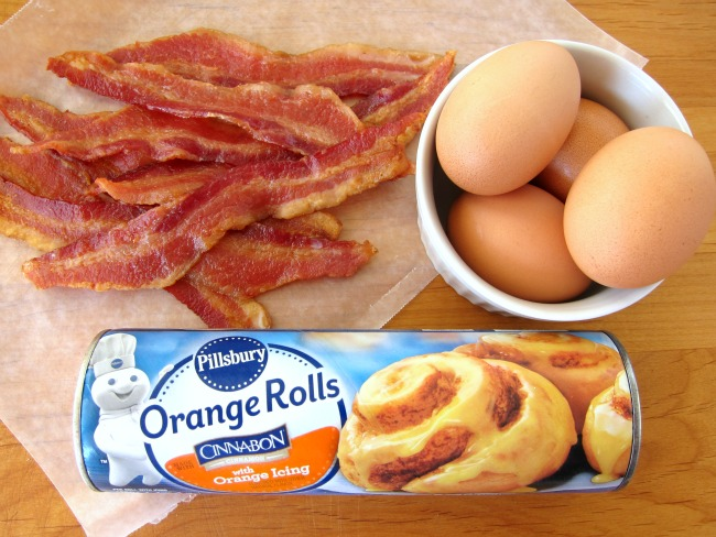 Assembling ingredients for Bacon-Orange Breakfast Sandwiches on ShockinglyDelicious.com